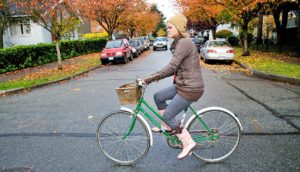 woman on a green bike