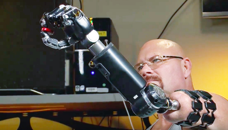 Man maneuvers robotic arm with his thoughts
