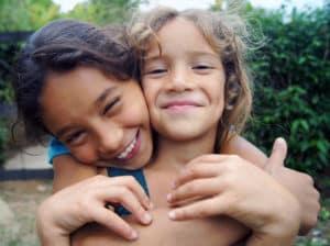 Columbian girls hugging