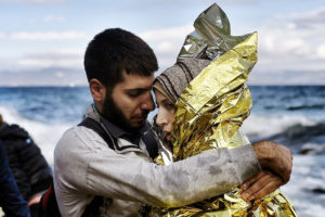 migrant man and woman embrace