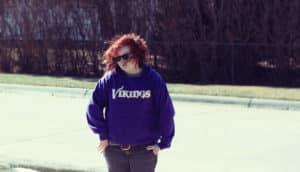 teen girl in Vikings sweatshirt