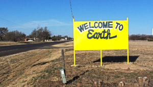 """""""Welcome to Earth"""" sign"""