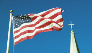 US flag and religious cross
