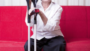 older woman with crutches