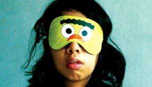 woman wears a sleep mask