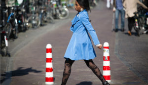 woman in a blue coat walking