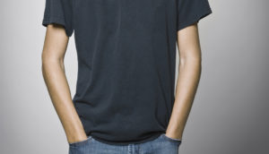 teenage boy with hand in pockets