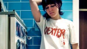 woman wears Dexter shirt