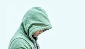 man wearing a green hoodie