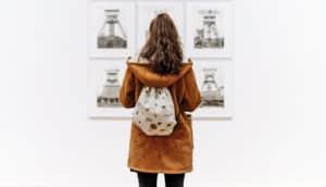 woman looks at Becher photos