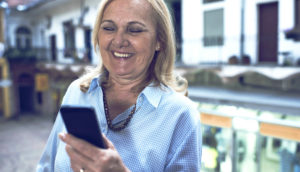 older woman reads her phone