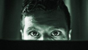 panicked eyes over laptop