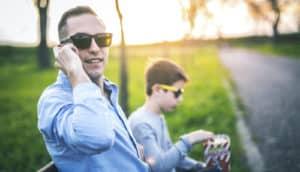 dad talks on a cellphone