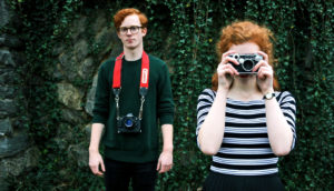 redheaded couple with cameras
