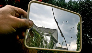 gable of house in cracked mirror