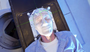 man receives radiation therapy