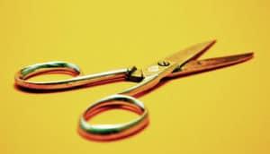 metal scissors on yellow