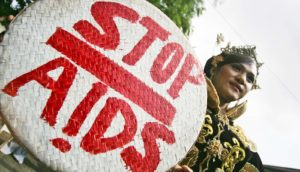 woman carries stop aids sign