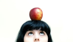 apple on a woman's head