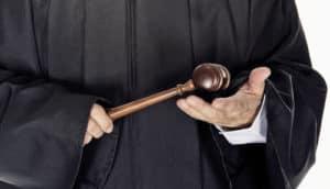 judge holds gavel