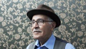 older man in front of wallpaper