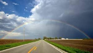rainbow over rural highway