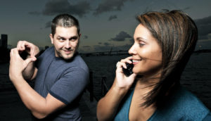man flirts with woman on phone