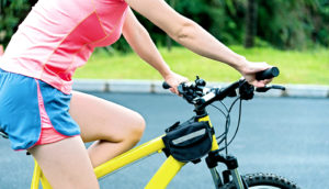 woman rides bicycle