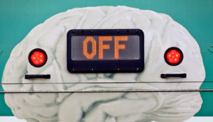 "brain mural with ""off"" sign"