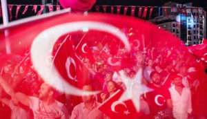 crowd of people in Turkey through the flag