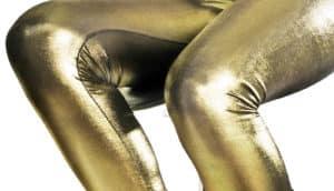 woman wears gold pants