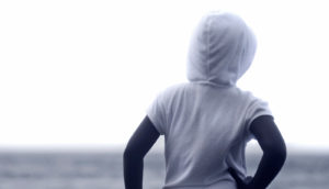child in hoodie in b/w