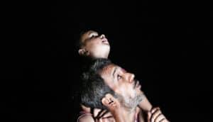 child on dad shoulders