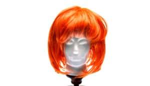 mannequin head in orange wig