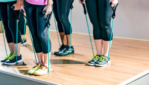 four women with resistance bands
