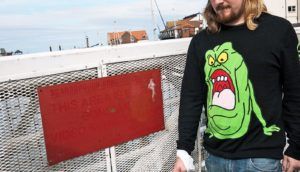 sad man wears slimer sweater