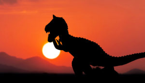 t-rex and red sunset