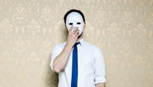 man in tie wears mask