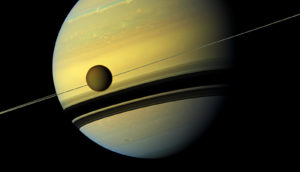Titan in front of Saturn