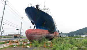boat inland after tsunami