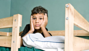 boy in bunk bed