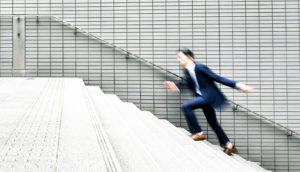 businessman runs up stairs