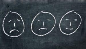 faces on chalkboard
