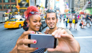 mixed-race couple takes selfie