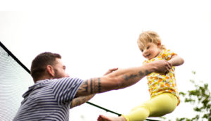 dad and daughter on trampoline