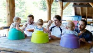 three dads feed babies