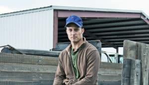 farmer sitting on a trailer