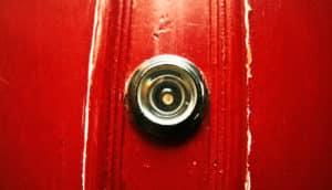peephole in red door