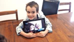 kid with grandparents via skype