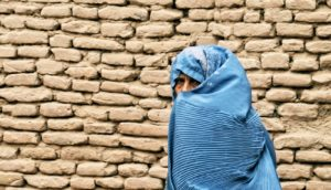 woman in blue in afghanistan